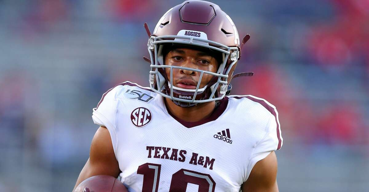 Kam Brown #18 of the Texas A&M Aggies warms up during a game at Vaught-Hemingway Stadium on October 19, 2019 in Oxford, Mississippi. (Photo by Jonathan Bachman/Getty Images)