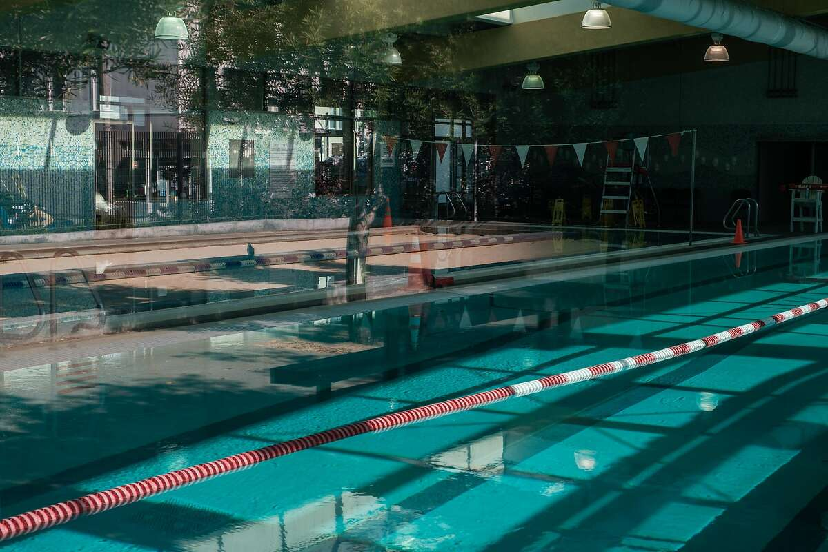 The pool at the YMCA in North Beach remains closed in San Francisco on Friday, October 30, 2020. Most activities that were scheduled to reopen or expand capacity on Tuesday are now delayed. That includes indoor swimming pools, bowling alleys and gym locker rooms. Restaurants and places of worship must remain at 25% capacity instead of bumping up to 50% as planned.