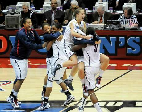 Connecticut players celebrate after winning the women's NCAA Final Four college basketball championship game over Stanford on April 6, 2010, in San Antonio. Connecticut won 53-47.