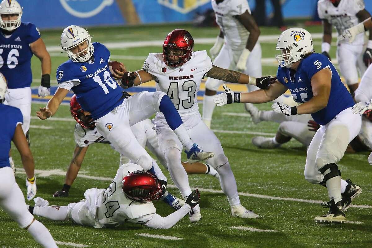 San Jose State quarterback Nick Nash, 16, gets wrapped up after a carry against the UNLV Runnin' Rebels on Nov. 14, 2020, in San Jose, Calif.
