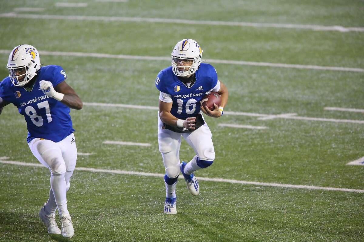 San Jose State quarterback Nick Nash, 16, scrambles behind the lead block of tight end Derrick Deese, 87, during the Spartans game against UNLV on Nov. 14, 2020. The Spartans are 4-0 this season.