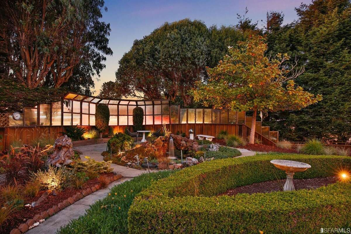 """""""The gardens are more reminiscent of a Hillsborough home than a San Francisco one,"""" said Macpherson. """"One could get lost in the west gardens, with a variety of lush plant life, fountain and pond, and a large terrace that's ideal for entertaining."""""""