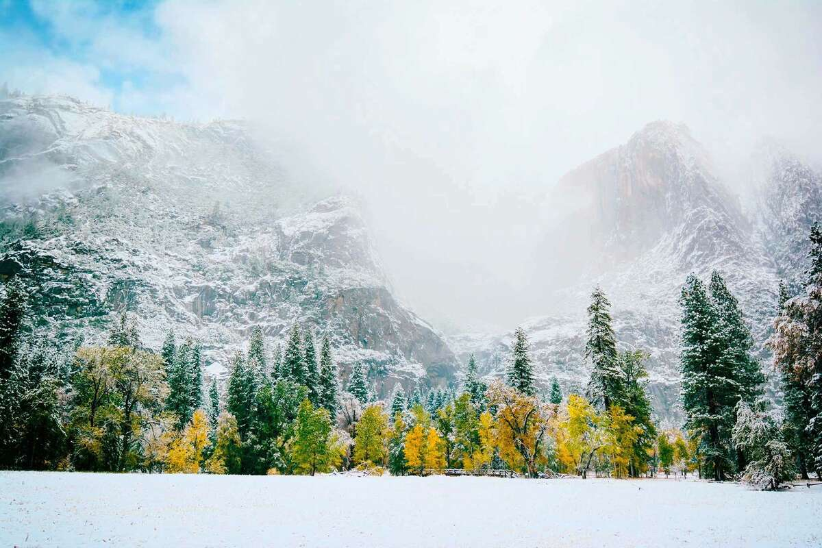 The season's first snow blows in over Yosemite's fall colors.