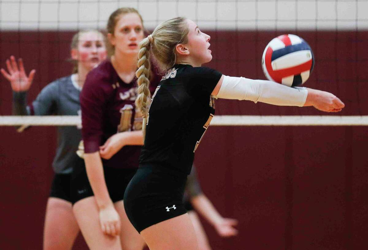 Magnolia West libero Ally Wendel (7), earlier this season, had a team-high 31 digs against College Station Monday night in a District 19-5A tiebreaker.