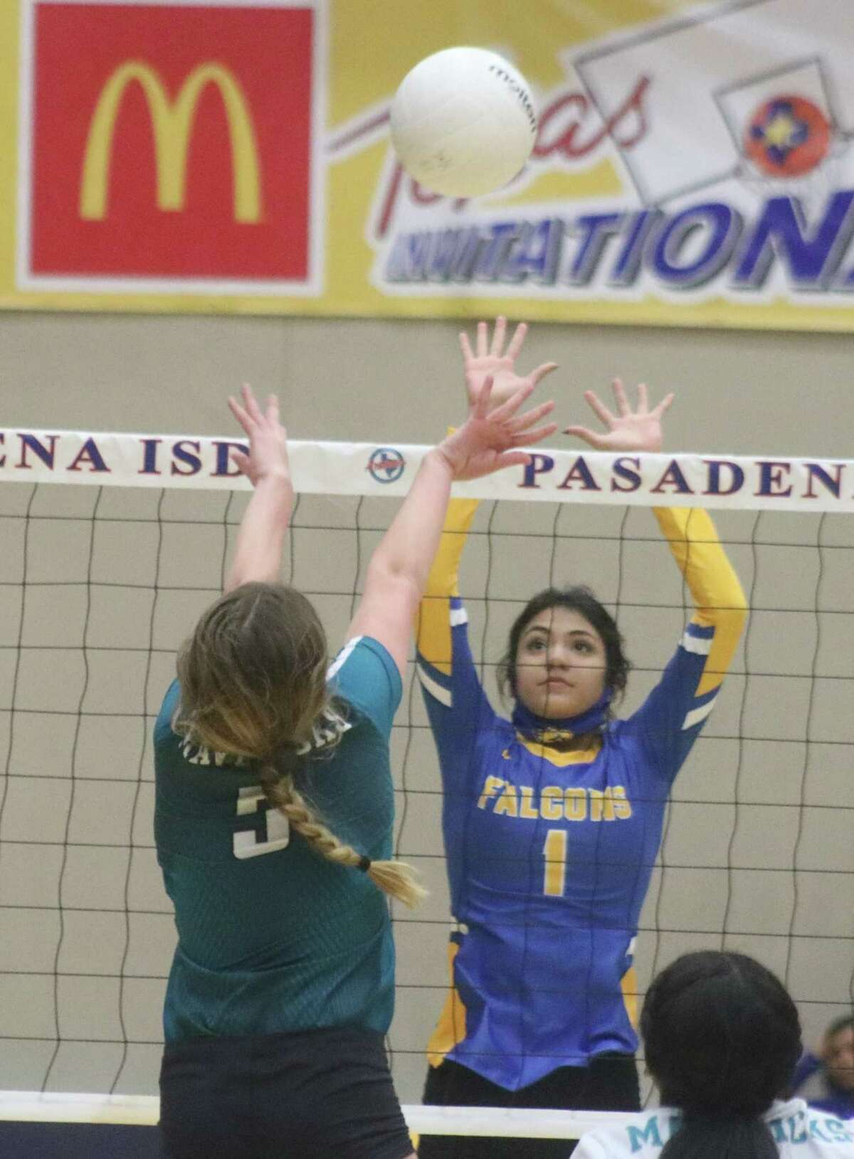 Memorial's Emma Carro and Channelview's Valeria Betancurth confront each other at the net during Monday night's battle for the third and fourth seeds at Phillips Field House.