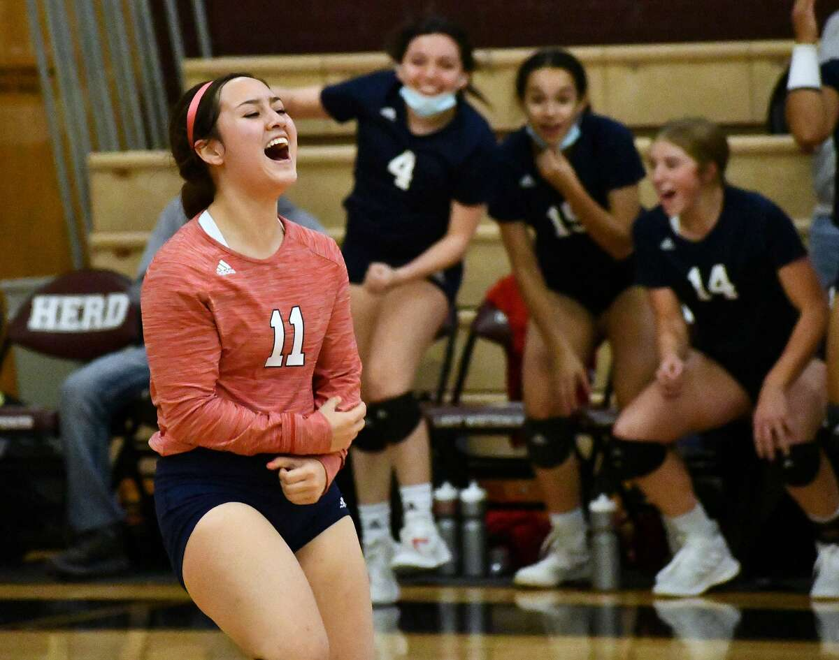 Senior Emily Sigala and her teammates celebrate the Plainview volleyball team's 3-0 sweep of Amarillo Caprock in a District 3-5A tiebreaker match on Nov. 16, 2020 in Hereford. The win gave the Lady Bulldogs their first playoff berth since 2015.