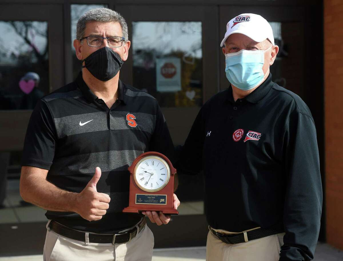 Shelton High School athletic director John Niski (left) was honored with the Athletic Director of the Year award by Paul Mengold, CIAC associate director of unified sports, at Shelton High School on November 6, 2020.