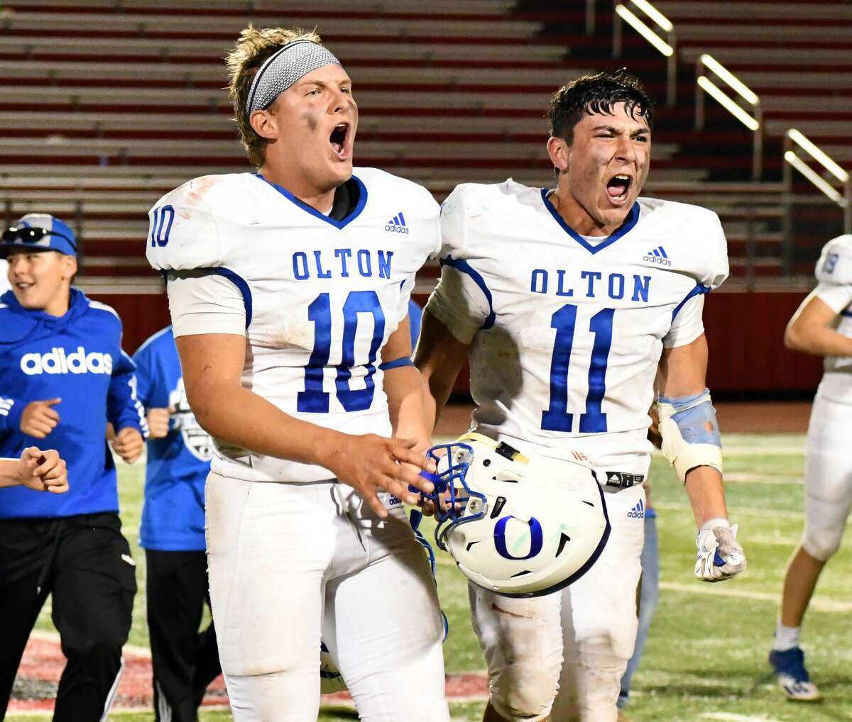 Seniors Jack Allcorn (10) and Aldo Vasquez celebrate Olton's 35-33 win over New Deal in their Class 2A Division I bi-district football game on Nov. 12, 2020 in Levelland.