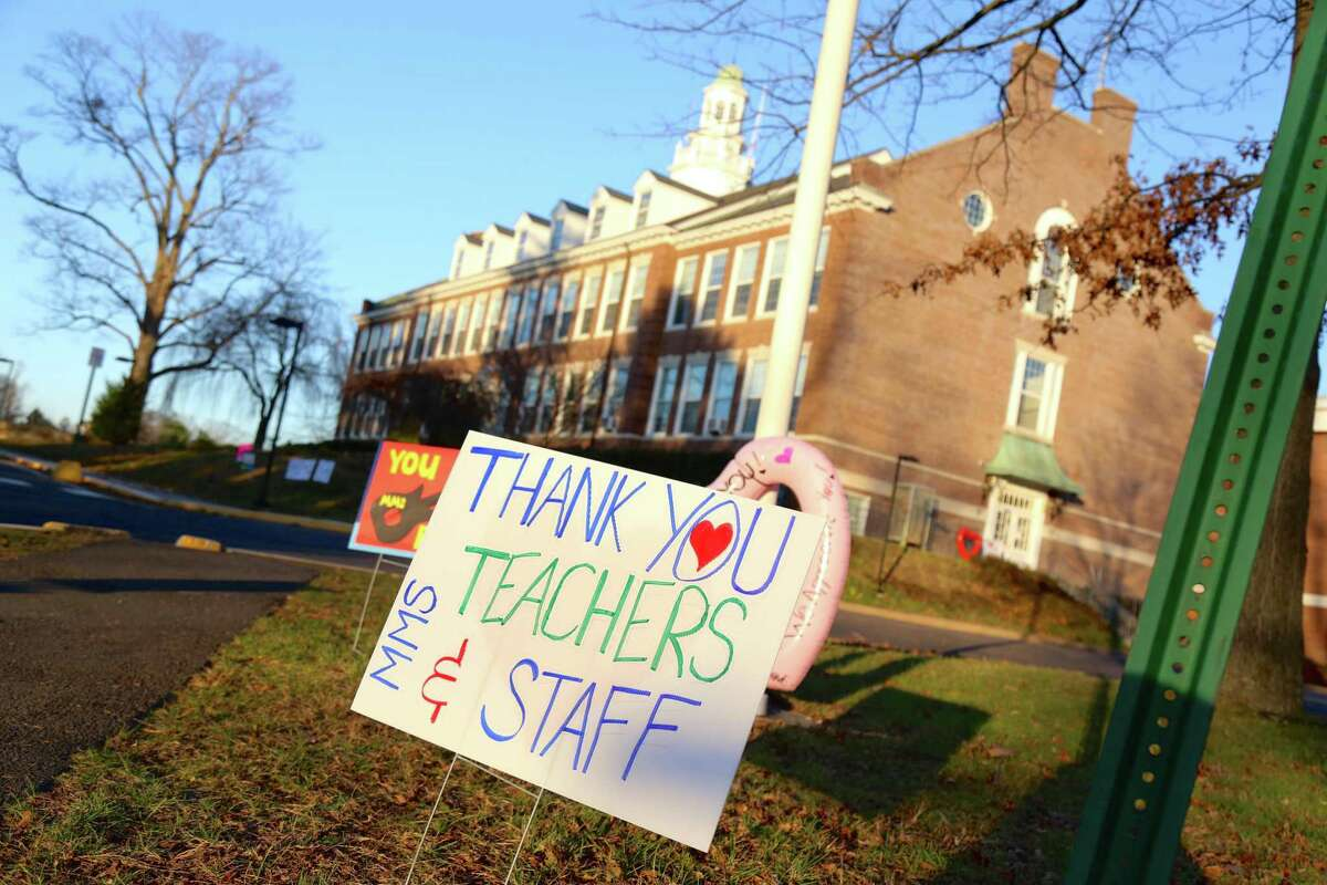 A sign sends love out to staff of Middlesex Middle School from a November campaign to show school staff appreciation.