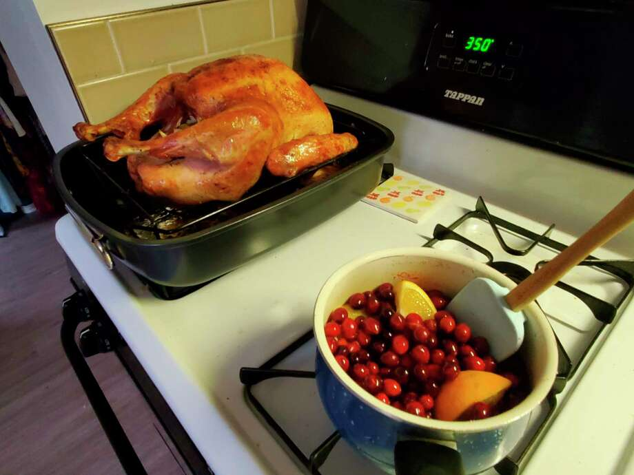 I let the turkey rest while I winged the cranberry sauce, which was a simple compote of cranberries, oranges, water, sugar and cinnamon. I ended up adding corn starch to thicken it up. (Ashley Schafer/ashley.schafer@hearstnp.com)