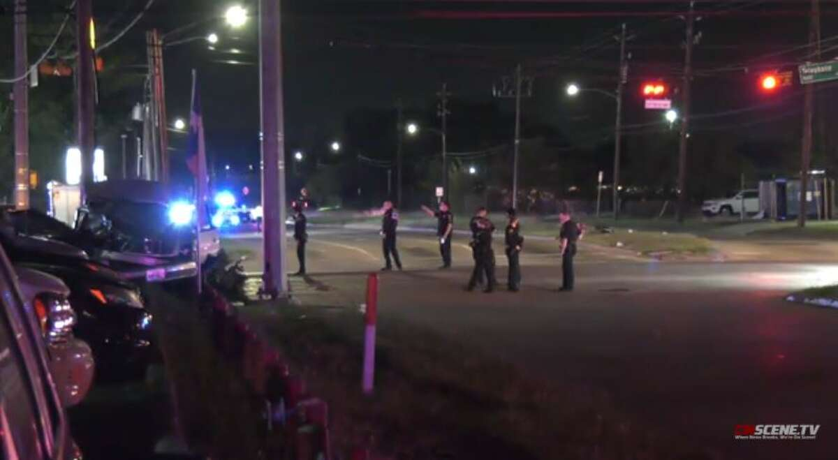 Authorities investigate two crashes that injured three people, including a constable deputy, after a high-speed chase in southeast Houston on Monday, Nov. 16, 2020.