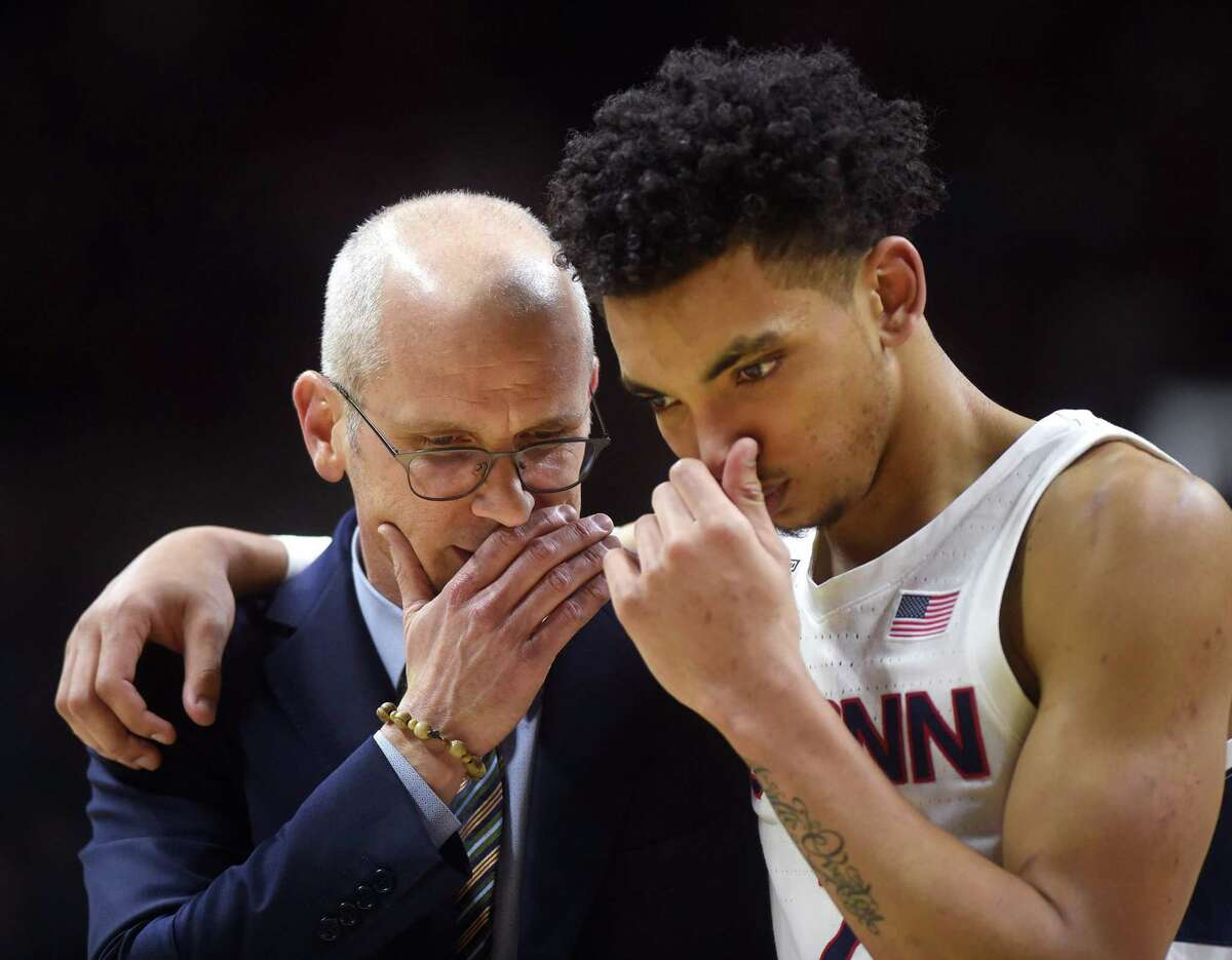 In this file photo, UConn coach Dan Hurley speaks with guard James Bouknight during a victory over Houston at Gampel Pavilion. (Brad Horrigan/Hartford Courant/TNS)