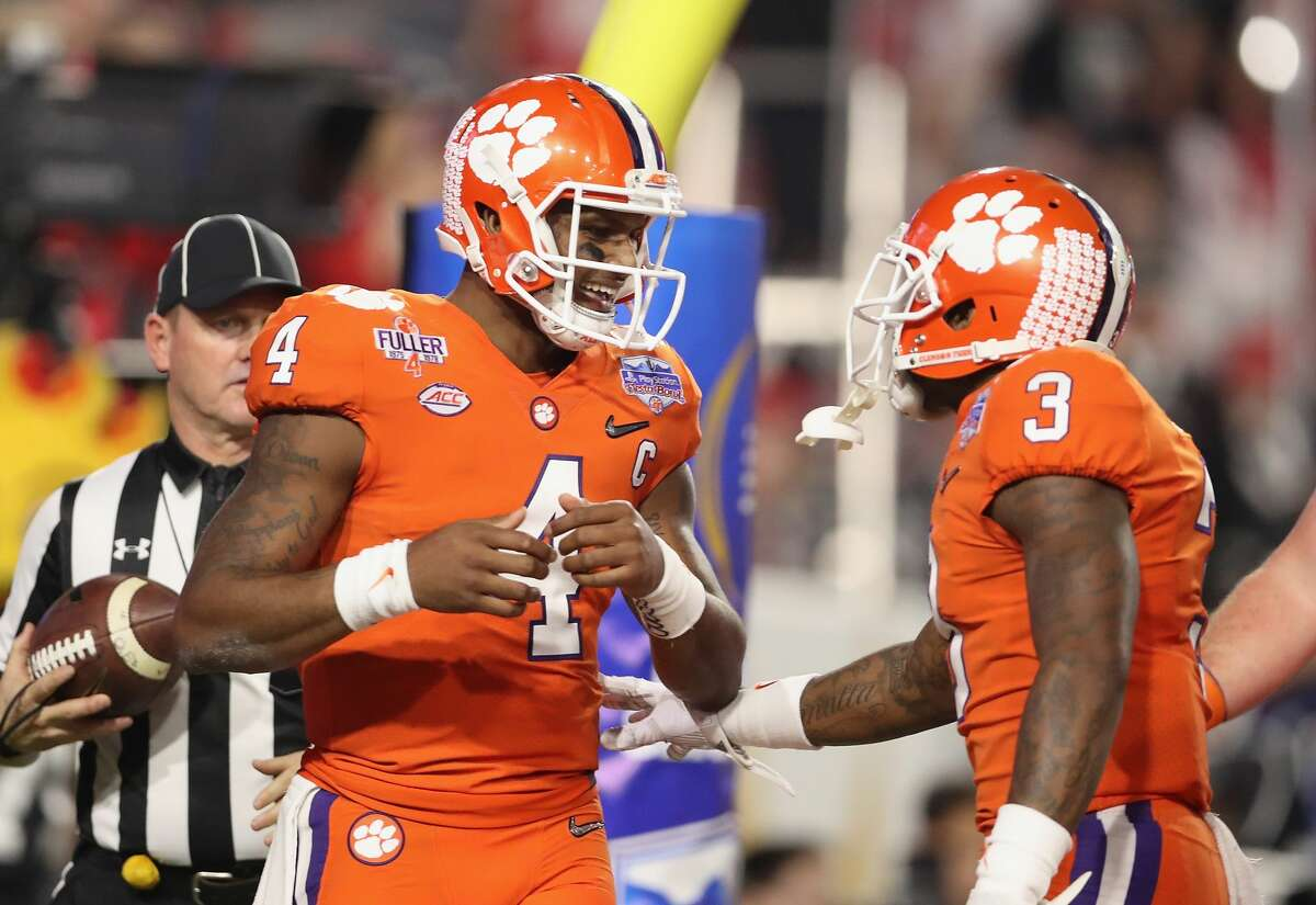 Deshaun Watson of the Clemson Tigers reacts with teammate Artavis Scott #3 after scoring a touchdown during the first quarter of the 2016 PlayStation Fiesta Bowl against the Ohio State Buckeyes at University of Phoenix Stadium on December 31, 2016 in Glendale, Arizona. (Photo by Christian Petersen/Getty Images)