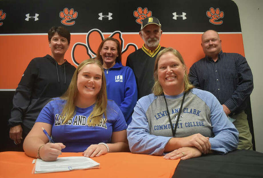Edwardsville High School senior Sam Sanders, seated left, will play softball at Lewis and Clark Community College. She is joined by her parents, club coach and EHS coach Lori Blade. Photo: Matt Kamp|The Intelligencer