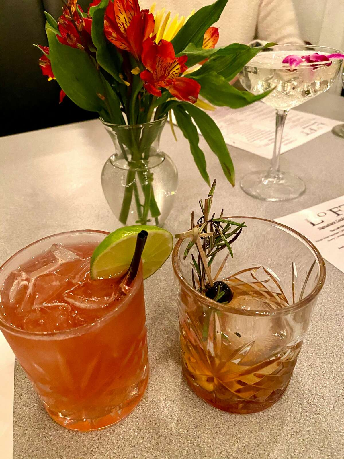 Cocktails from The Loft @205 in Albany include a blackberry bourbon smash, left, and The Loft Old Fashion. (Susie Davidson Powell for the Times Union.)