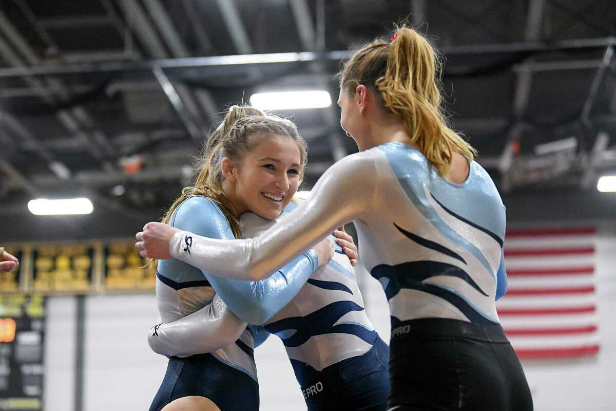 Wilton' Lilly Byrnes is congratulated after competing in the floor exercise during the CIAC Class M Gymnastics Championship at Jonathan Law, Saturday, February 29, 2020.