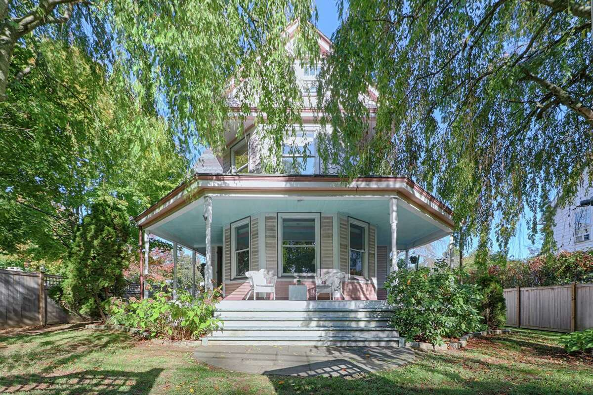 The coral pink-colored antique Queen Anne Victorian house at 122 Stratfield Road in Fairfield's Stratfield neighborhood was built in 1894 but was modernized for today's living.