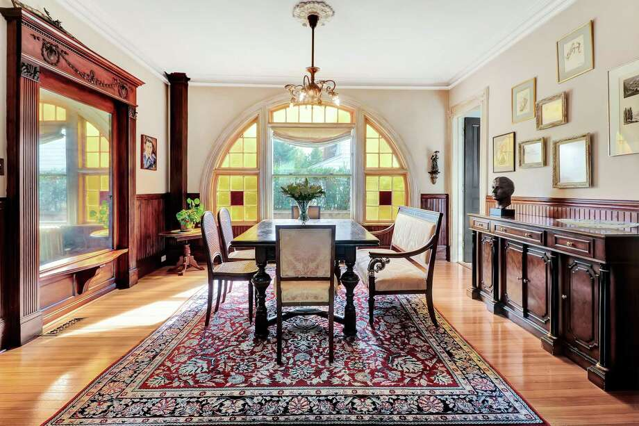 In the formal dining room there is an ornate, large scale, built-in mahogany mirror and an arch with amber-colored glass window panes surrounding a large picture window. The coral pink-colored antique Queen Anne Victorian house at 122 Stratfield Road in Fairfield definitely qualifies as unique. Its next owners can be assured there is not another quite like it. It was built in 1894 and has retained its character, charm and many of its period details, even through a 2004 renovation and a more recent updating project, both of which imbued the home with modern amenities and styling.  Photo: Contributed Photo /