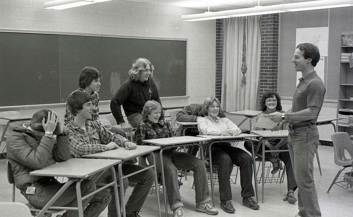 """From the Nov. 19, 1980 issue of the News Advocate, """"The Manistee Senior and Junior High School ski teams began their sausage and cheese sale today in an effort to raise funds for the ski program. Shown above are ski team members Renee Gillespie, John Olsen, Lori Fauble, Marna Cushing, Tia Badalamente, Jason Pickett, Rick Montgomery and Ted Jack as they discuss plans for the sale with team coach Dan Janowiak."""""""