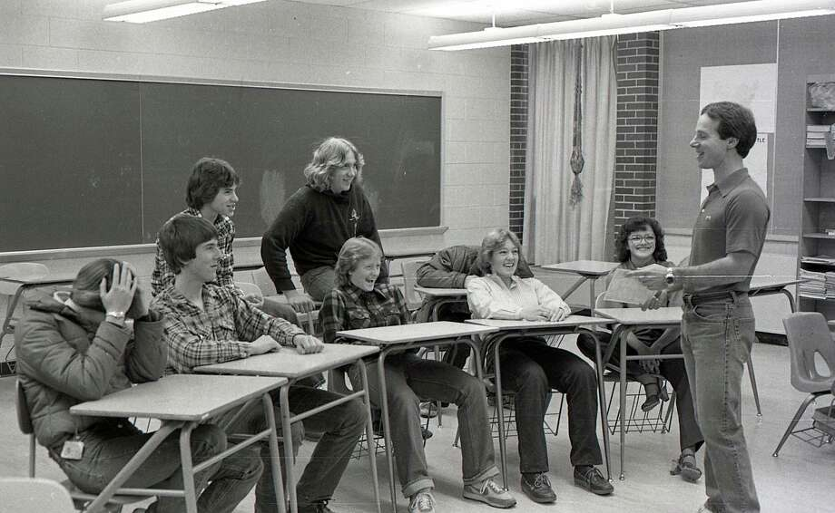 "From the Nov. 19, 1980 issue of the News Advocate, ""The Manistee Senior and Junior High School ski teams began their sausage and cheese sale today in an effort to raise funds for the ski program. Shown above are ski team members Renee Gillespie, John Olsen, Lori Fauble, Marna Cushing, Tia Badalamente, Jason Pickett, Rick Montgomery and Ted Jack as they discuss plans for the sale with team coach Dan Janowiak."""