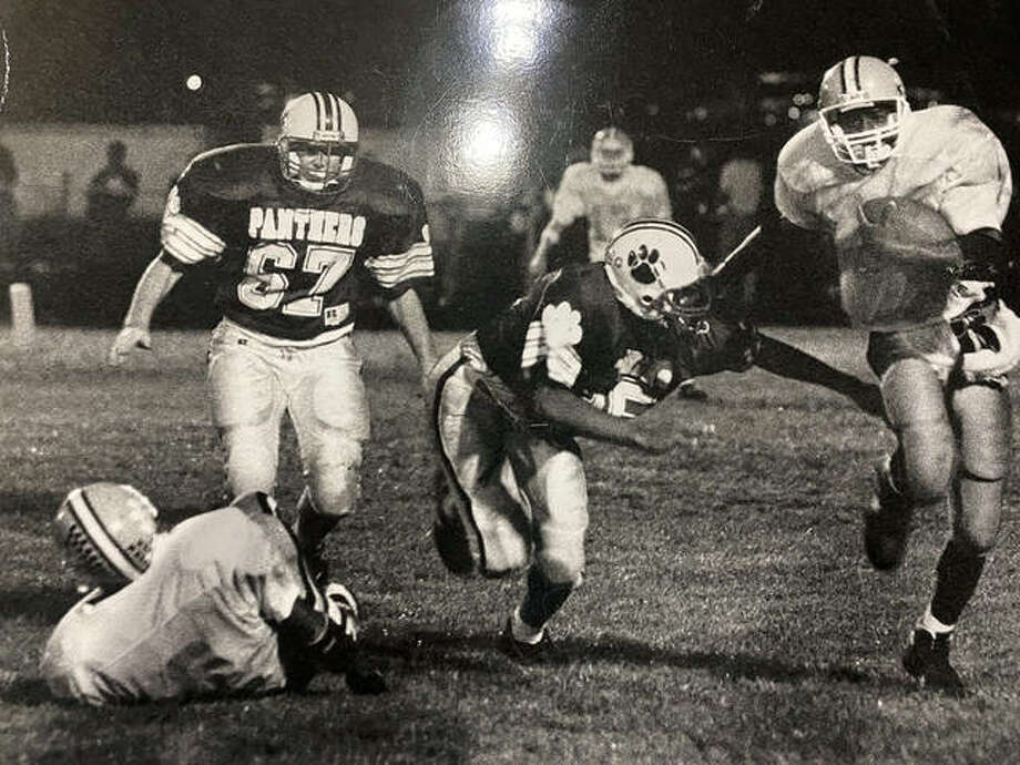Edwardsville tailback Mark Thomas, right, picks up yardage in a game against O'Fallon during his senior season at EHS in 1994. Photo: For The Intelligencer