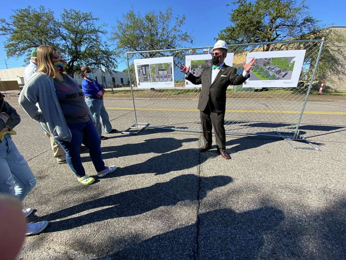 Lamar State College Orange President Thomas Johnson shows the renderings for future academic center.
