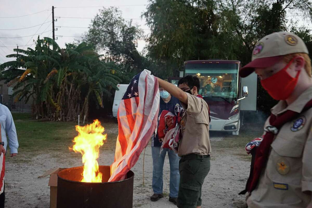 Boy Scouts from Troop 925 help retire old, tattered American flags in a special ceremony hosted by American Legion Post 164 on Saturday, Nov. 14, at Elks Lodge No. 2628 in Katy.