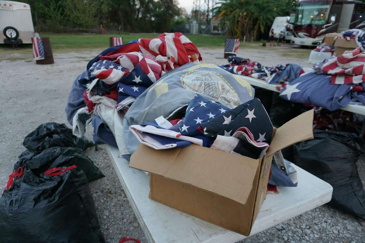 Hundreds of old, tattered American flags wait to be retired in a special ceremony hosted by American Legion Post 164 on Saturday, Nov. 14, at Elks Lodge No. 2628 in Katy.