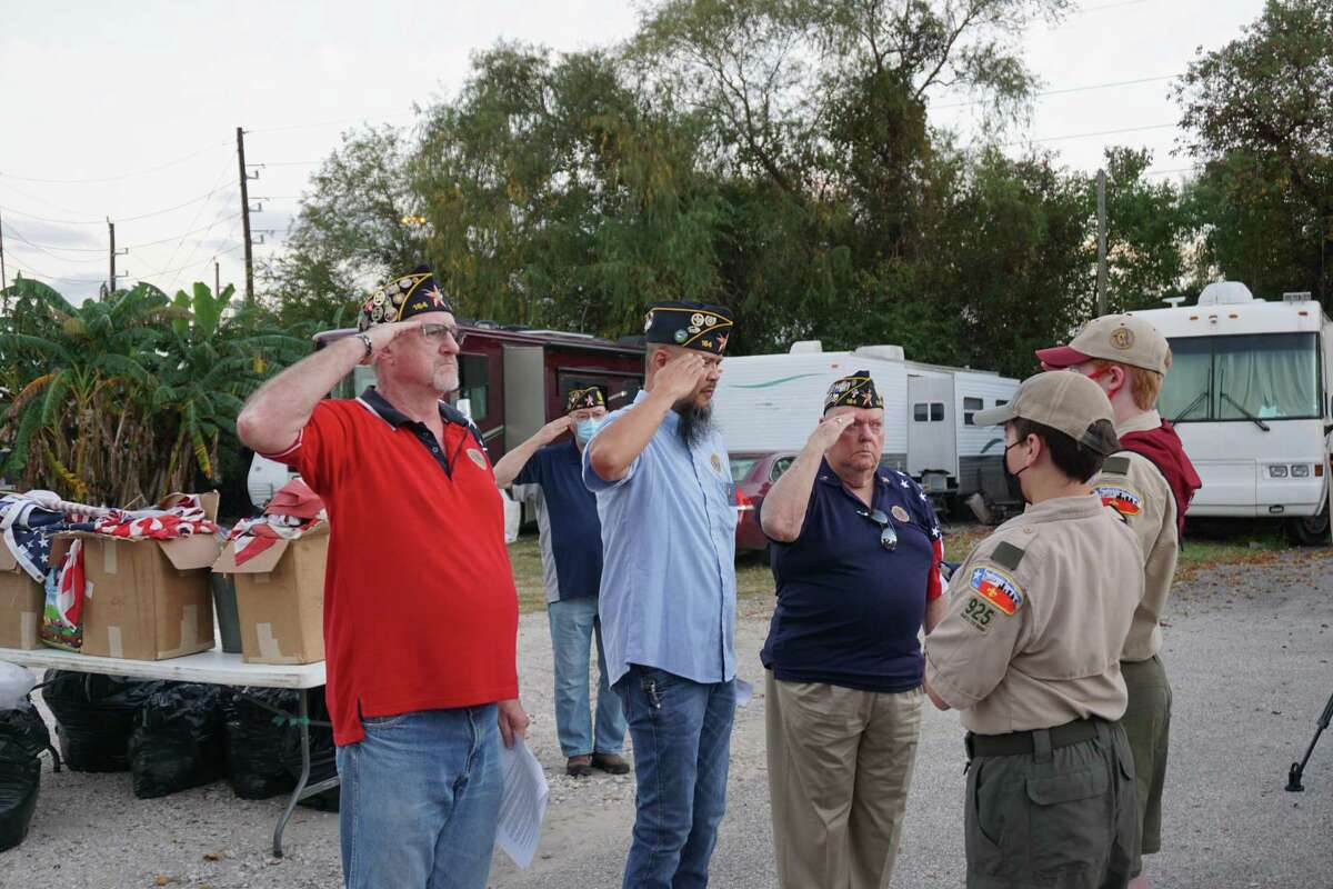 Comrades from American Legion Post 164 salute during an American flag retirement ceremony on Saturday, Nov. 14, at Elks Lodge No. 2628 in Katy.