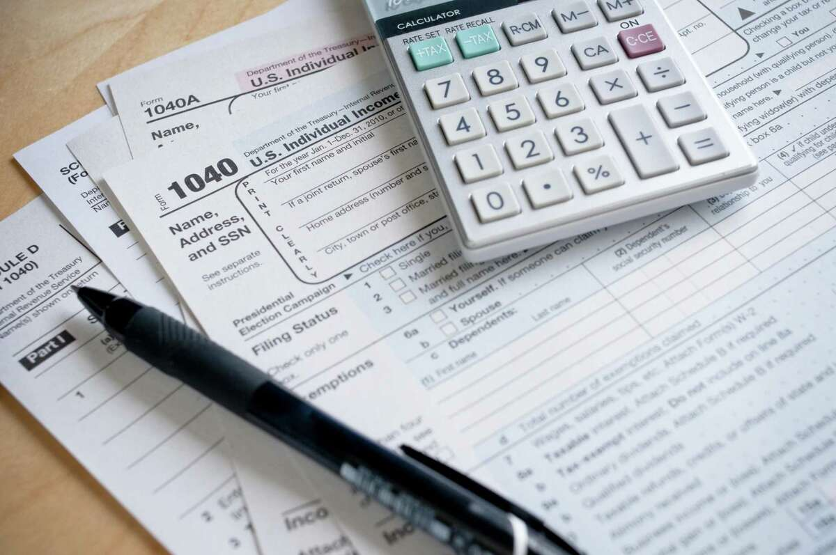 A file photo of tax forms. Starting on Jan. 1, 2021, all Connecticut employees will have a few more dollars taken out of their paychecks as the state implements a new payroll tax to help fund Connecticut's Paid Family Leave Program.