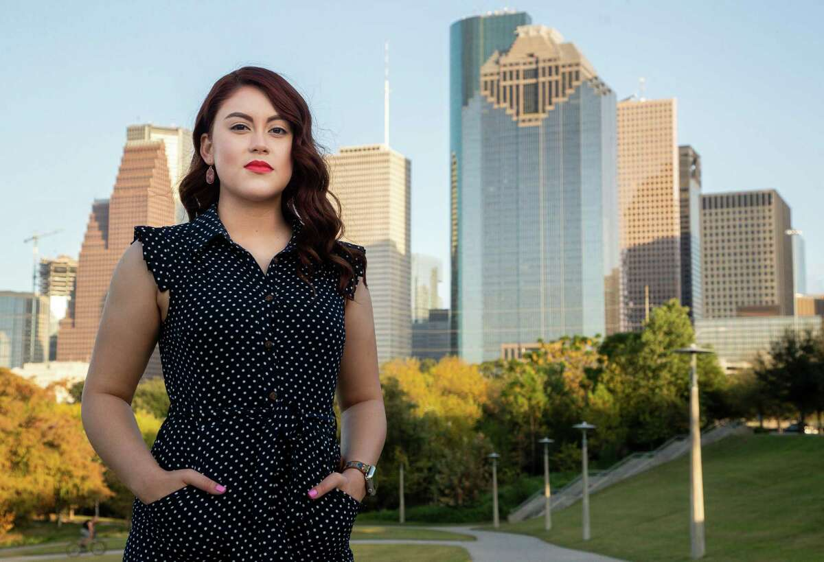 Devani Gonzalez, 24, poses for a photograph at Eleanor Tinsley Park on Wednesday, Nov. 11, 2020, in Houston, Texas. Gonzalez, who is a recipient of the Deferred Action for Childhood Arrivals program, works as a paralegal at the Harris County Attorney's Office, has three degrees from San Jacinto College, and expressed her relief that Donald Trump is not the president-elect.
