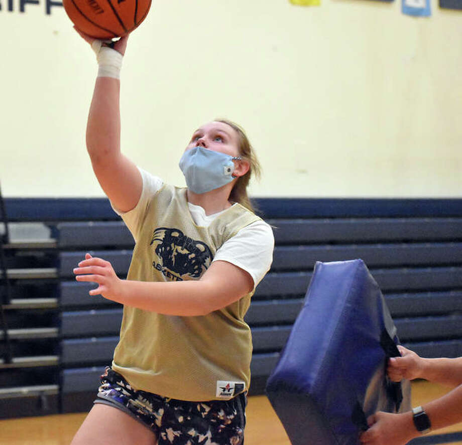 FMCHS senior guard Rachel Maller goes up for a contested layup during Monday's practice. Photo: Matt Kamp|The Intelligencer