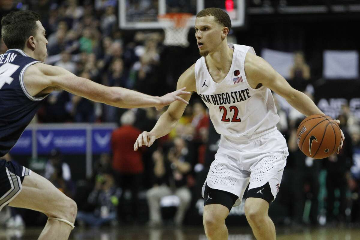 Position: Point guardMeasures: 6-2, 185 poundsSchool: San Diego State2019-20 stats (32 games): 17.6 points, 5.1 assist, 4.5 rebounds, 1.8 stealsConnection to Washington: Tacoma native Flynn, who played his high school ball at Bellarmine Prep in Tacoma, emerged as one of the top floor generals in college basketball at San Diego State. Helping to lead an Aztecs' squad that clinched a No. 1 seed in the NCAA tournament, Flynn showcased an ability to score at all three levels and was a pesky on-ball defender, named the Mountain West Defensive Player of the Year last season. He was one of the most efficient pick-and-roll players in the country, too. Flynn has risen during the pre-draft process, putting himself in a position to be drafted as early as the late first round. Lightly recruited out of Bellarmine Prep, Flynn played two seasons at Washington State before transferring to San Diego State.