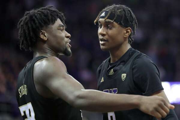 SEATTLE, WASHINGTON - JANUARY 18: Isaiah Stewart #33 (L) and Jaden McDaniels #0 of the Washington Huskies have a conversation in the second half against the Oregon Ducks during their game at Hec Edmundson Pavilion on January 18, 2020 in Seattle, Washington. (Photo by Abbie Parr/Getty Images)