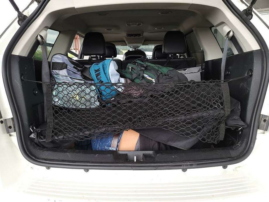 An individual can be seen in the cargo area of this sport utility vehicle. U.S. Border Patrol agents said they found three people inside the cargo area. All were immigrants who were in the country illegally. Photo: Courtesy Photo /U.S. Border Patrol