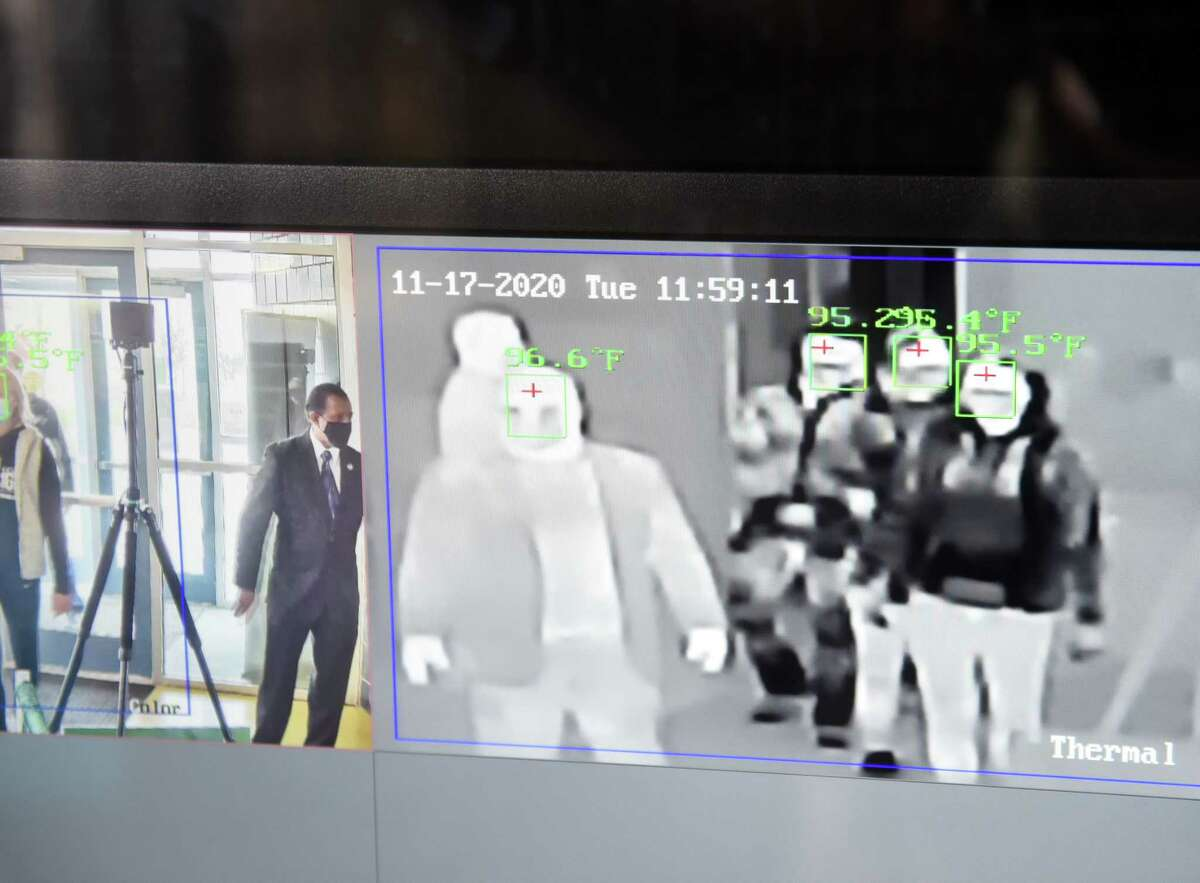 Thermal imaging cameras scan body temperatures of people entering the Guenther Enrollment Services Center building at Hudson Valley Community College on Tuesday, Nov. 17, 2020, in Troy, N.Y. The thermal equipment from Shepherd Communication and Security is used to detect elevated body temperatures, an indicator of possible COVID-19 infection. (Will Waldron/Times Union)