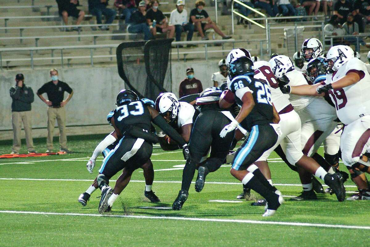 Pearland's Darius Hale (4) muscles into the end zone against Shadow Creek Friday, Nov. 13 at Alvin ISD Freedom Field.