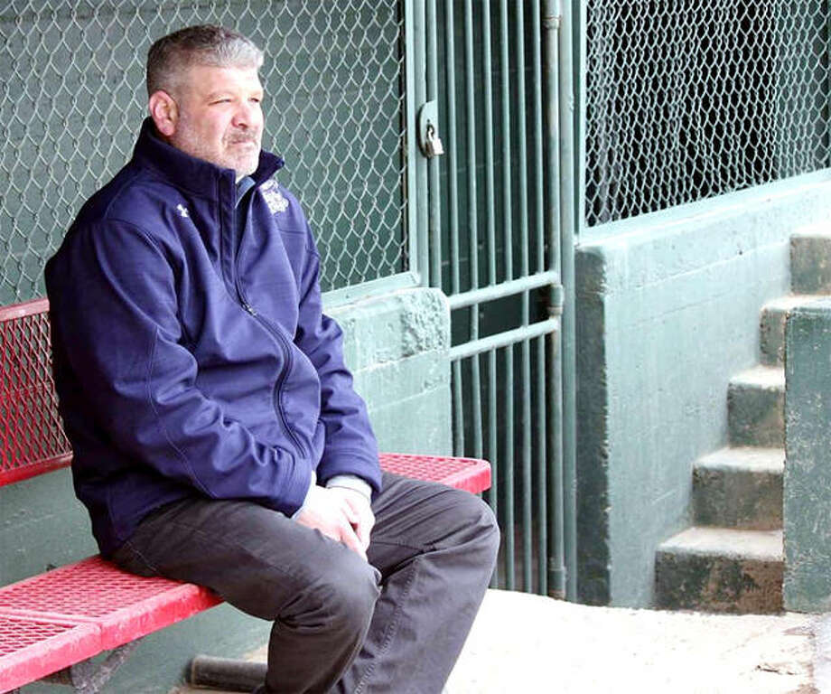 Darrell Handelsman, the new Alton River Dragons field manager, is stepping back into the dugout after spending time in the front office with the Souris Valley Sabre Dogs as general manager. Above, Handelsman sits in the dugout at Corbett Field in Minot, North Dakota, home of the Sabre Dogs. Photo: Alex Eisen | Minot Daily News