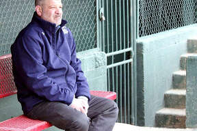 Darrell Handelsman, the new Alton River Dragons field manager, is stepping back into the dugout after spending time in the front office with the Souris Valley Sabre Dogs as general manager. Above, Handelsman sits in the dugout at Corbett Field in Minot, North Dakota, home of the Sabre Dogs.
