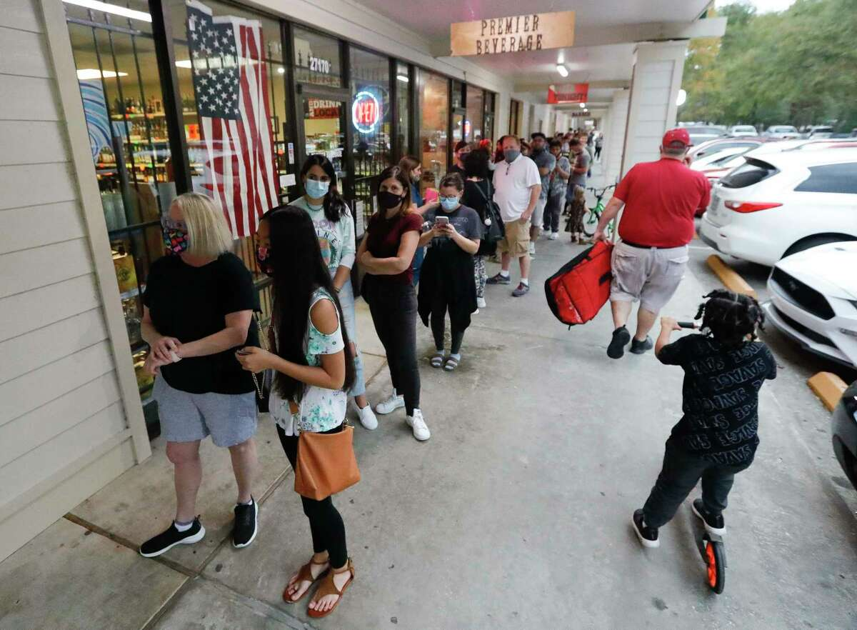 Customers line the shopping center to shop at The Candy House, Friday, Nov. 13, 2020, in Spring. The popular candy shop in The Woodlands had a bad month of business in October due to COVID-19, leading a regular customer to take to social media to plead with the community to help owner Donald Baker and his business.