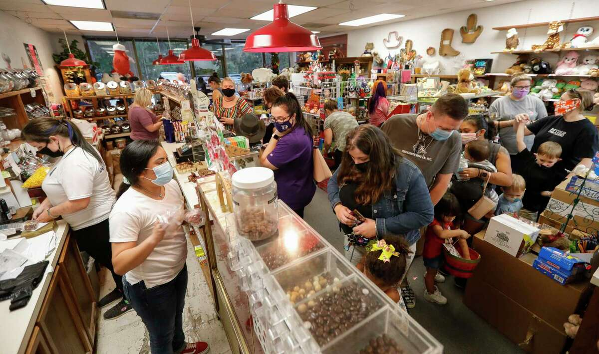 Customers pack The Candy House, Friday, Nov. 13, 2020, in Spring. The popular candy shop, located on Glen Loch Drive in The Woodlands had a difficult mont of business in October, a situation that caused a regular customer to take to social media to plead with the community to help him and his business.