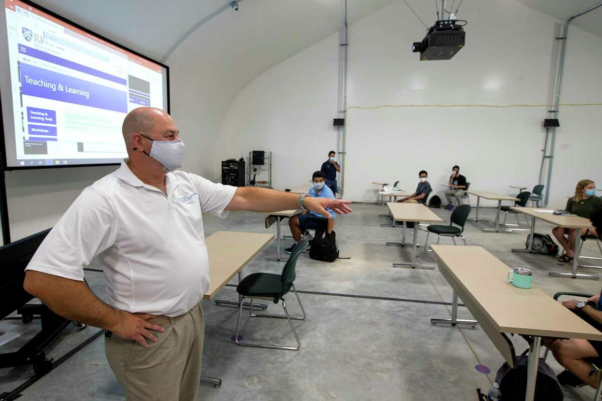Kaz Karwowski, executive director Rice Center for Engineering Leadership, speaks to his students during an engineering lab in one of the recently built temporary buildings on the Rice University campus on Wednesday, Sept. 2, 2020, in Houston. The temporary buildings have been brought to the campus to help with social distancing during classes amid the coronavirus pandemic.