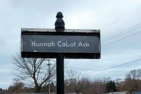 Hannah Cabot, the CASMAN Academy Student of the Month,poses next to the sign that names the school driveway in her honor. (Courtesy photo)