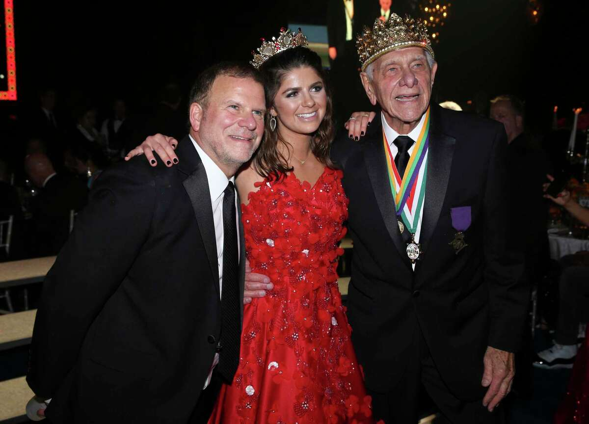 Tilman Fertitta, left, poses for a photograph with his father and San Luis Salute King Vic Fertitta and his daughter and Queen Blayne Fertitta after their coronations at the 2019 San Luis Salute during Galveston Mardi Gras. The 2021 festivities have been canceled.