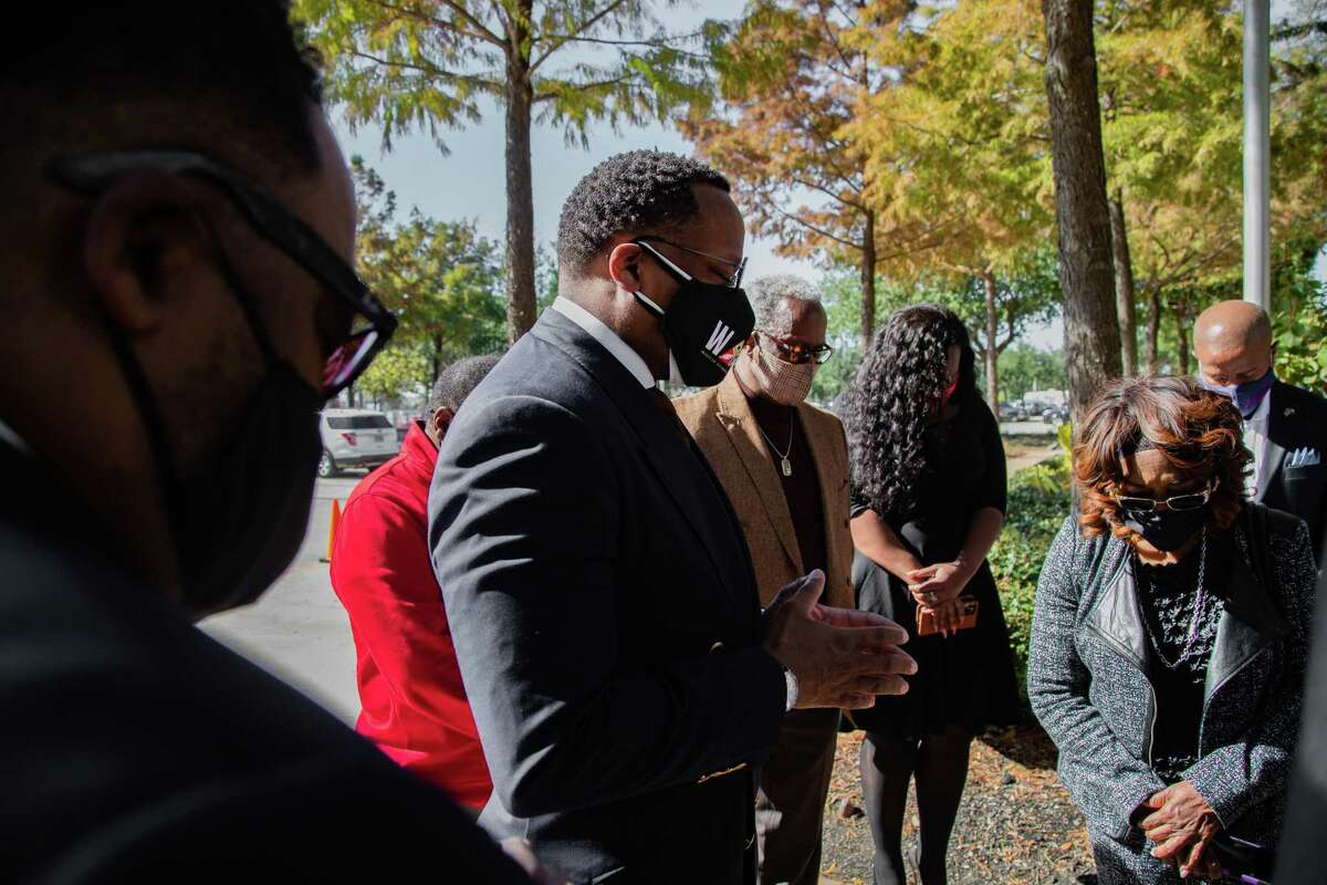 Marcus Cosby, center, and other Houston leaders gather in prayer before a press conference in front of the HISD Administration Building, Tuesday, Nov. 17, 2020, in Houston. The leadership gathered to publicly support Grenita Lathan as HISD as superintendent.