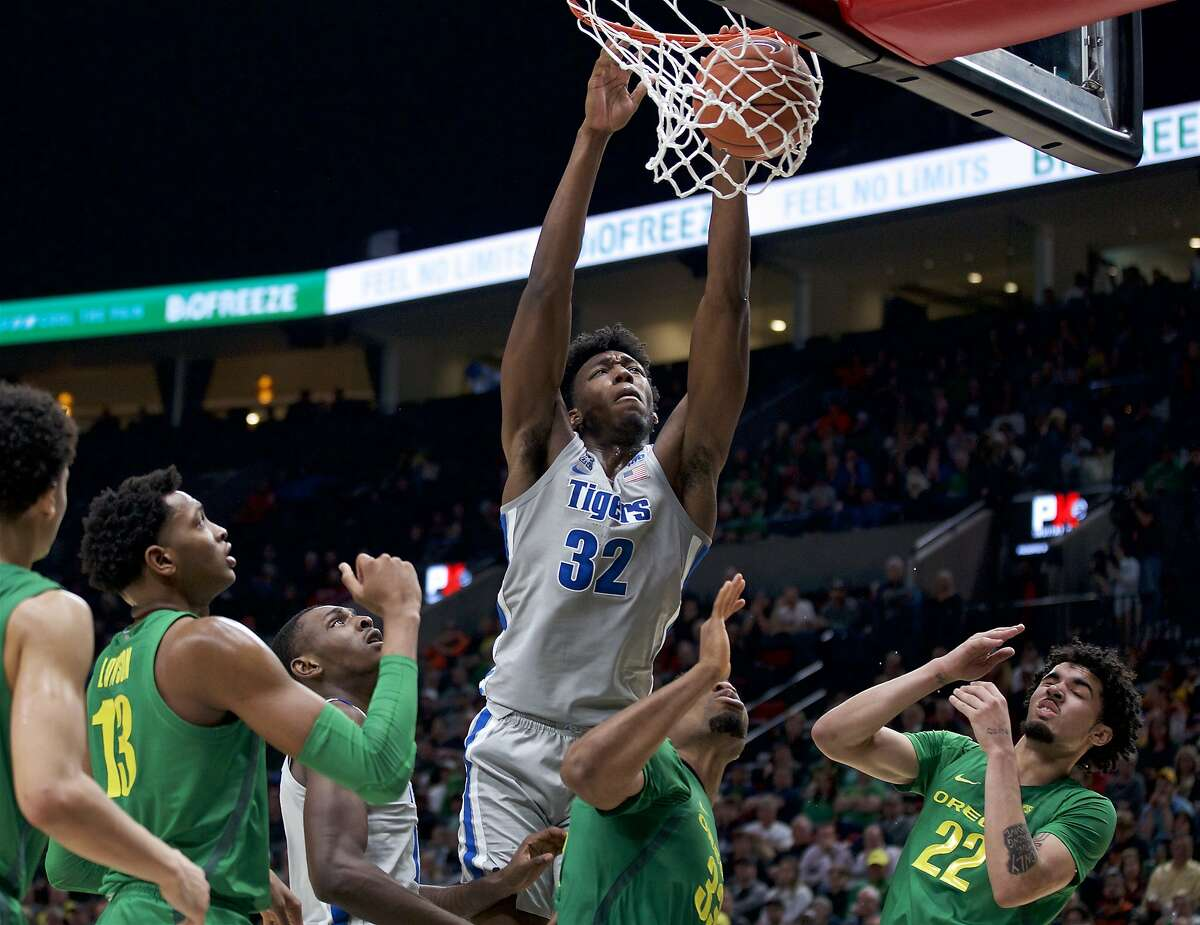 Memphis center James Wiseman (32) dunks against Oregon during the second half of an NCAA college basketball game in Portland, Ore., in this Tuesday, Nov. 12, 2019, file photo. At long last, James Wiseman is about to be on a team again. More than a year removed from the end of his three-game college career that was doomed almost before it started because of NCAA rulings regarding his eligibility, the 7-foot-1 left-hander will be one of the first players selected in Wednesday's, Nov. 18, 2020, NBA draft. It's hard to envision a scenario where he doesn't go in the first three picks, which are currently held by Minnesota, Golden State and Charlotte.