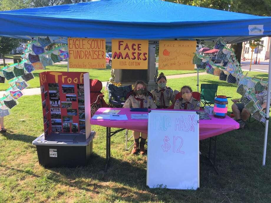To raise funds for her Eagle Scout project, Brooke Thibodeau, left, of New Milford, a member of New Fairfield Troop 179, made and sold masks. Photo: Courtesy Of The Thibodeaus / Danbury News Times Contributed