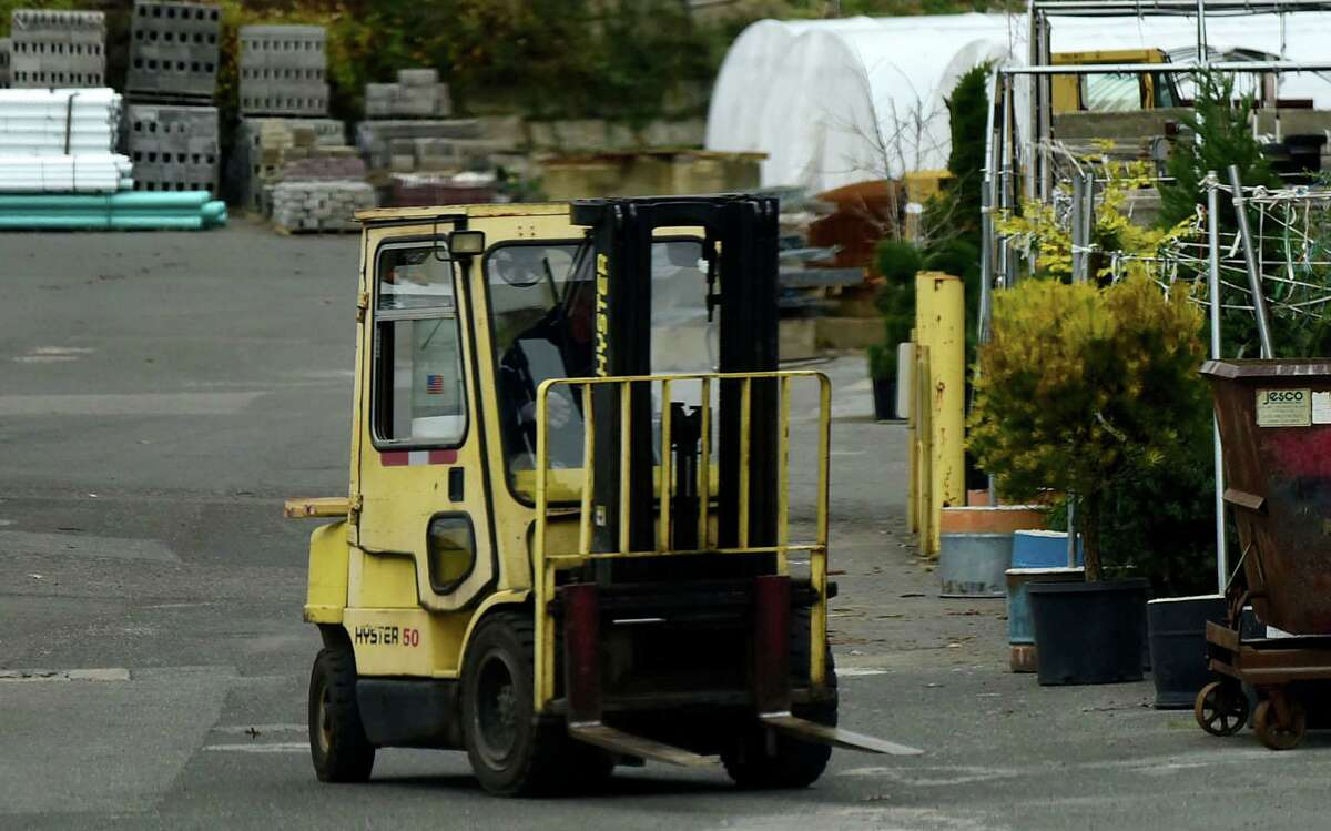 A driver maneuvers a forklift in November 2020 at Hatch & Bailey Co. in Norwalk, Conn. The city of Norwalk is weighing the best way to keep some of its existing industrial zones vibrant while allowing for conversion of some properties to new uses.