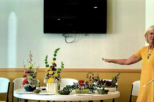 Vickie Johnson shares tips on floral arrangement techniques during the November meeting of the Spirit of the Woods Garden Club, Inc. (Courtesy photo)