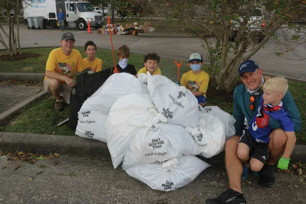 Members of Friendswood Cub Scout Pack 452 pose with their collection of litter that was picked up from Centennial Park during Fall Haul.